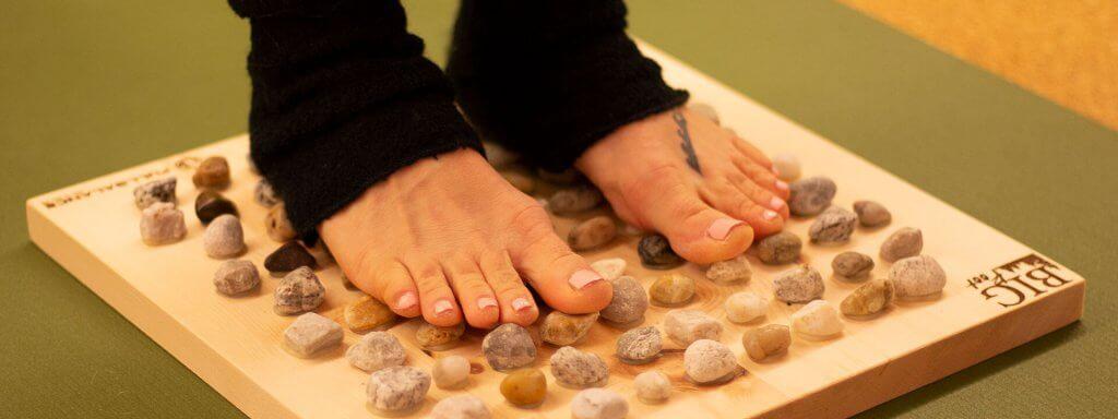 Fußreflexzonenmassage zur Regeneration nach dem Laufen