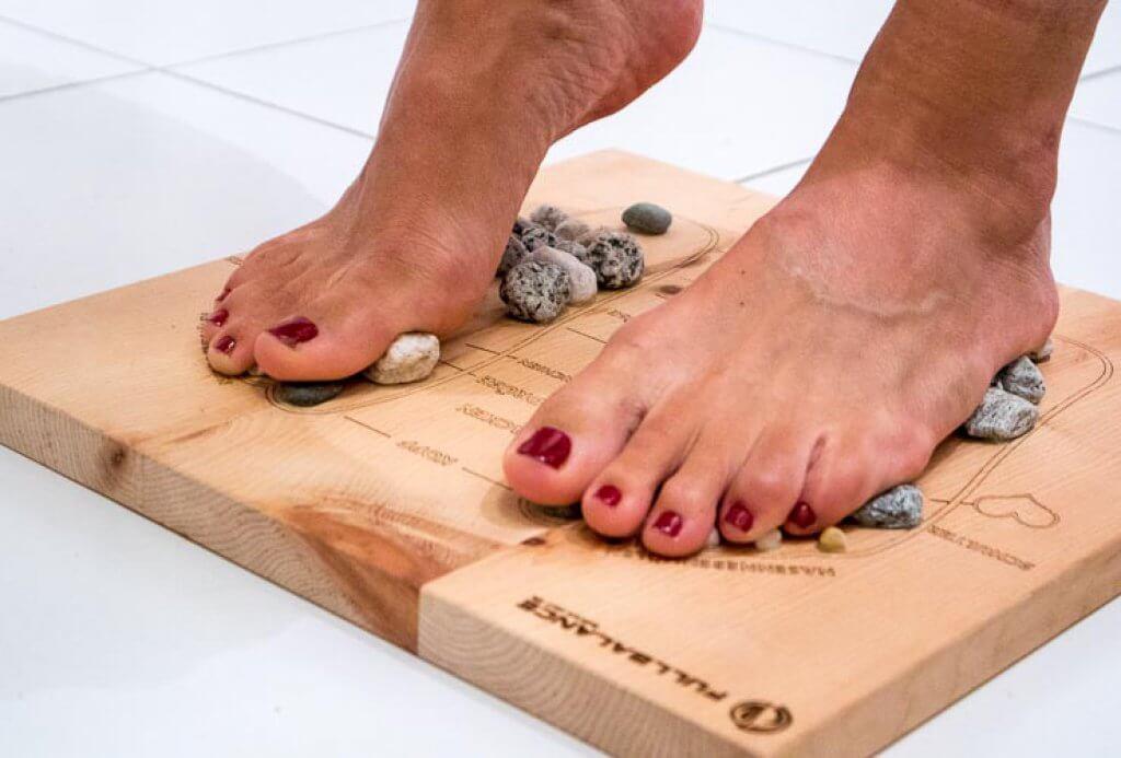 Massage der Fußreflexzonen bei Plantarfasziitis
